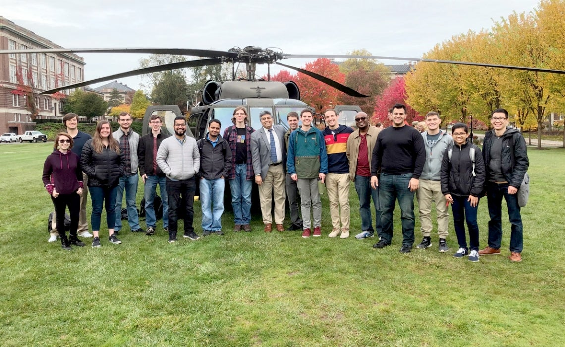 MOVE students with Black Hawk helicopter